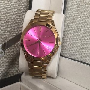 Michael Kors watch, gold with hot pink face
